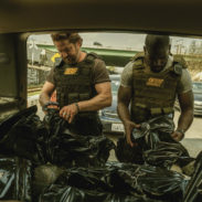 Gerard Butler and Mo McRae star in DEN OF THIEVES